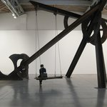 Tour group with Mark Di Suvero sculpture