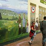 Outdoor mural commemorates the Free State Constitution outlawing slavery in Kansas in downtown T