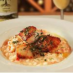 Pan seared Scallops over Lobster and Truffle Risotto