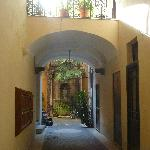 After walking through a hidden wooden door you see this cute little courtyard.  Then take elevat