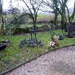 Ancient farm implements in garden at Smithy Fold