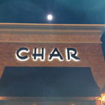 Exterior of Char, with full moon in background