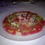 Veal carpaccio in Pomegranate vinagrate