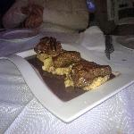 Entrecote steak with red wine sauce on polenta