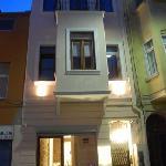 Marti Apartments building illuminated at night