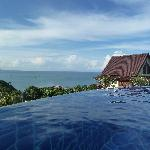 view from the pool on yellow villa and the sea