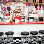 sit at the counter or a booth, vintage record album covers fill the ceiling