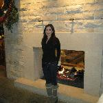 Getting toasty by the fireplace (bar is in the back left of photo)
