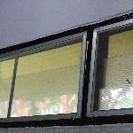 dirty window screens in bathroom