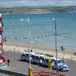 A view of Weymouth bay from the house, with the Jubilee Clock and the Land Train in the foregrou