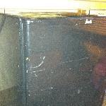 The beat up mini fridge