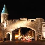 old city gate at night