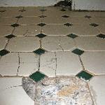 Bathroom floor - dangerous loose tiles