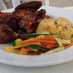 Jerk chicken with steamed vegetables and Jamaican Rice