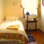 The creamy yellow single bedroom
