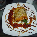 White fish wrapped in filodough with salad, tomato sauce and balsamic vinegar (can't remember wh