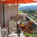 Balcony with patio table and comfortable patio chairs