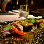 Liquid nitrogen frozen balsamic vinaigrette, marinated potato and sama (fish)  The plates were b