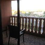 #606 Covered balcony, with 2 chairs and views of the mountains