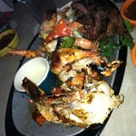 Beef, chicken, shrimp and lobster fajitas for two!