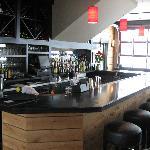 A full, casual bar.