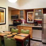 Fully equipped kitchen in each suite