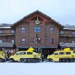 Vintage Bombardier snow-coaches lined up at the Snow Lodge