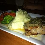 Roasted chicken, mushroom ravioli, and sides