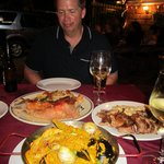 Charles with our paella, veal shank and lamb ribs