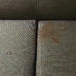 Stained & holey sofa
