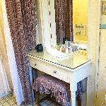 Dressing table in the charming vintage bathroom.