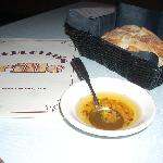 Bread and savory olive oil are brought to the table as soon as you order.
