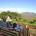 Breakfast with the steaming volcano in the background