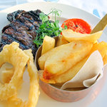 rib eye steak (look carefully and you can see the chip with the black corner)