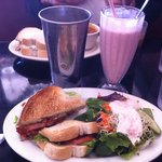 BLT sandwich with a green salad and a strawberry milkshake