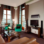 Deluxe Corner Suite living room with views over Jardin Anglais and Lake Geneva.