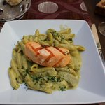 Penne pasta in pesto sauce with salmon