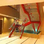 glass staircase to breakfast area