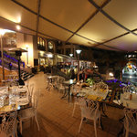 Restaurant at night outdoors.