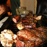 Mixed grill, included steak, short ribs, beef sweetbreads, sausage, and chicken