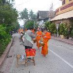 monks walking near hotel