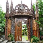Huge woodcarved gate - entrance to the facilities.