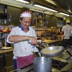 A chef at Chez Black cooking pasta