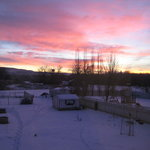The sun rises, as viewed out the bedroom window