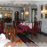 Royal paintings enrich the restaurant interior....