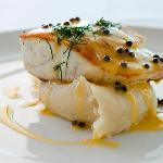 Pan fried snapper with potato and garlic mash; lemon caper butter