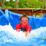 My boy at the top of the water slide :)