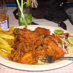 Wonderful tiger prawns masala with chips and salad