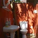 Outdoor bathroom to wooden fan bungalow.