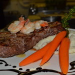 New York surf and turf, served with mashed potatoes and vegetables